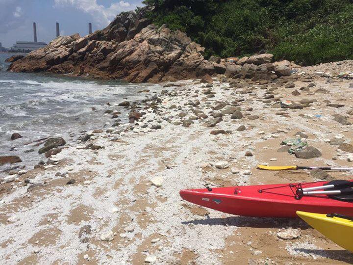 Palm oil blobs cover HK beaches after sea crash