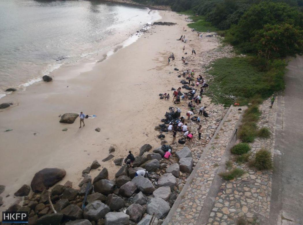 palm oil spill beach clean-up