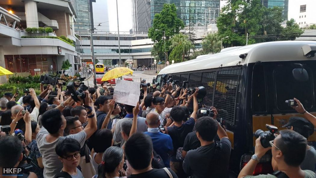police van occupy activists