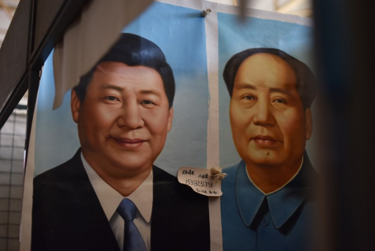 Xi joins Mao in Chinese Communist Party constitution