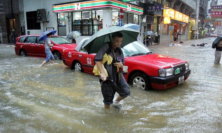 Flooding hits the Western side of Hong Kong close to the Central district after a torrential downpour 24 June 2005