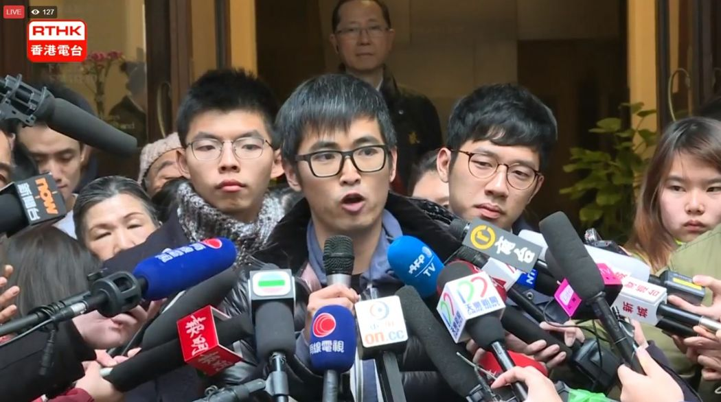 Court lets Joshua Wong, friends walk free