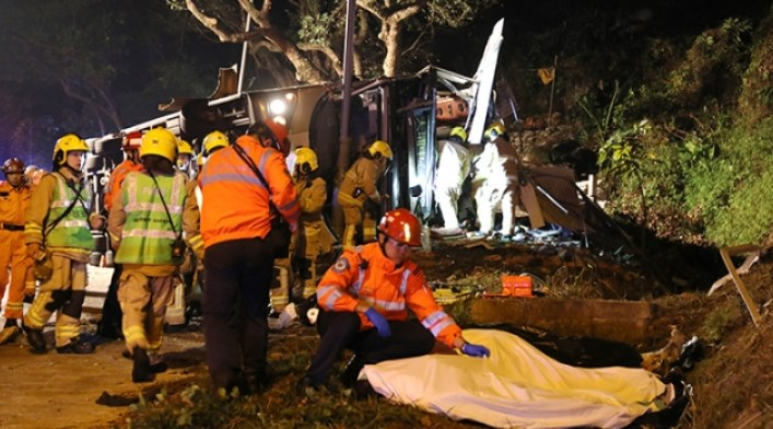 Hong Kong bus overturns, killing at least 19 people