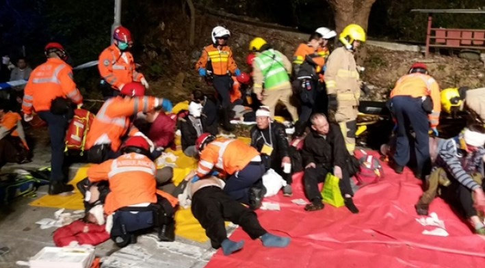 HK double-decker topples over, killing 18