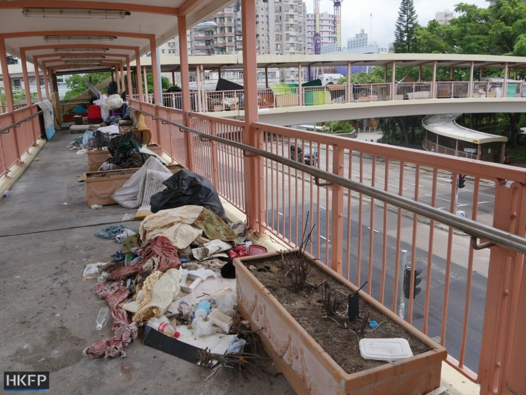Yen Chow Street footbridge homeless belongings living quarters
