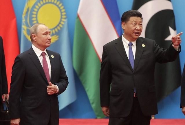 Russia's Vladimir Putin and China's Xi Jinping