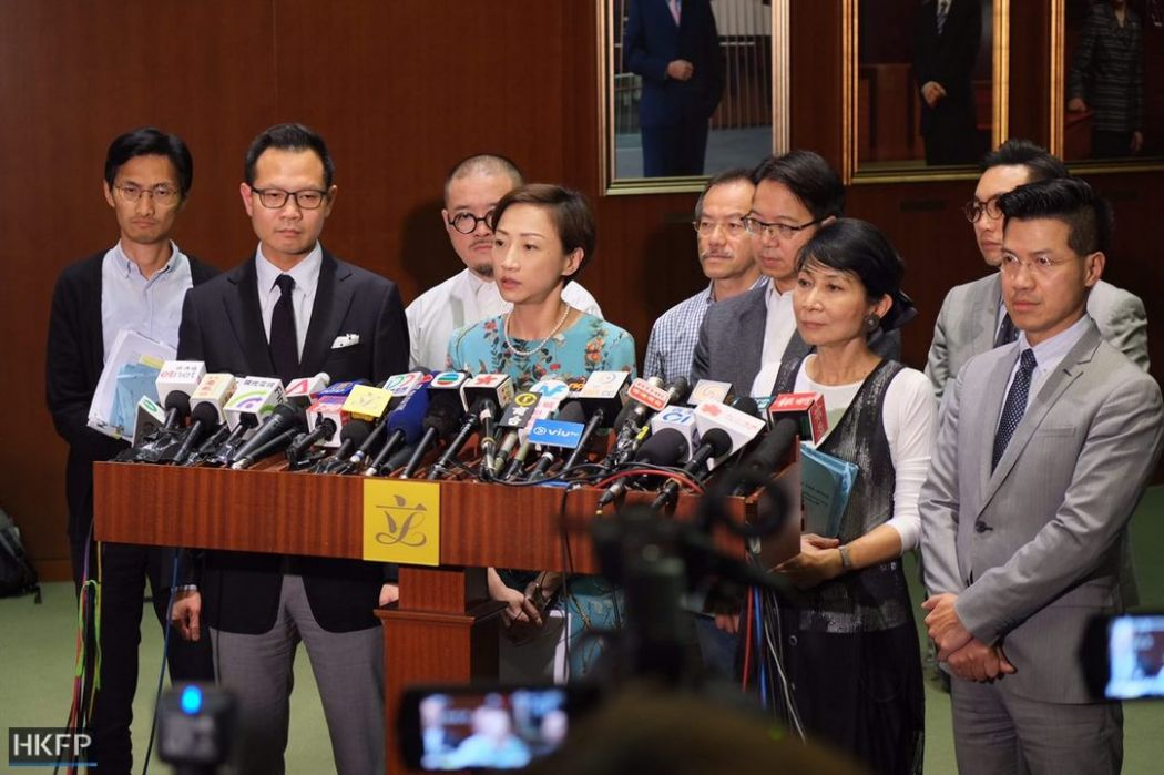 Pro-democracy lawmakers outside legislative chamber after joint checkpoint bill vote