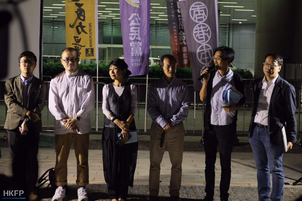 Pro-democracy lawmakers outside legislative council building after joint checkpoint bill vote