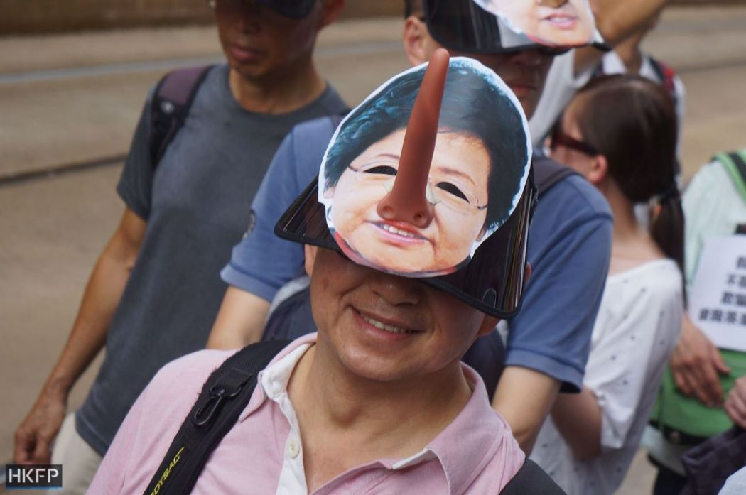 carrie lam july 1 democracy rally protest march