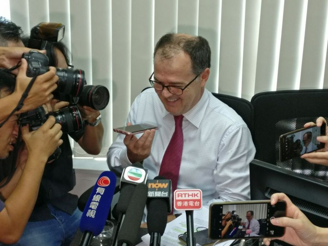 Human rights lawyer Michael Vidler speaking to QT over the phone. Photo: Holmes Chan/HKFP.