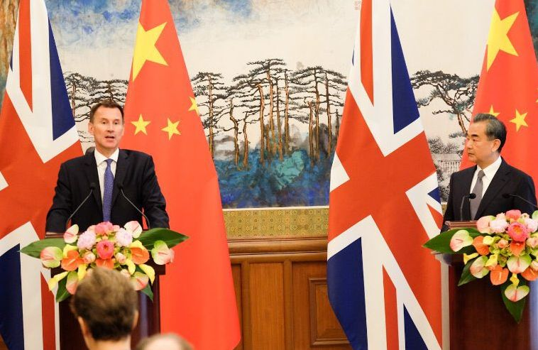 Jeremy Hunt and Wang Yi.