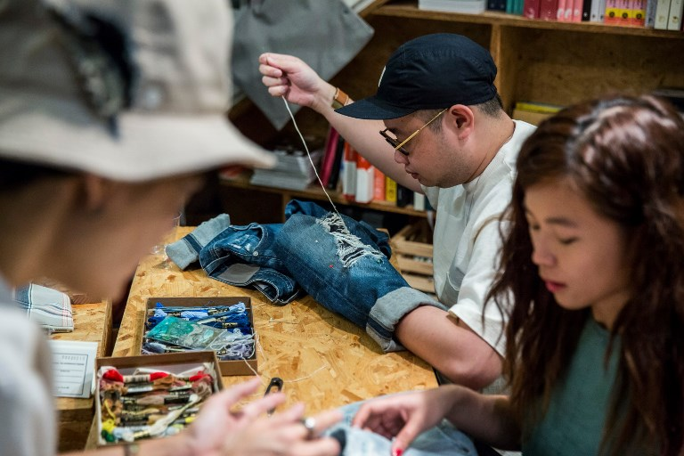 Hongkongers fight 'fast fashion' as clothes-mending