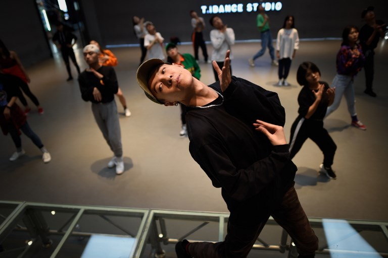 hip-hop dancer Chong Yang, a coach of T.I. Studio, leading a hip-hop dance class at the studio in Beijing.