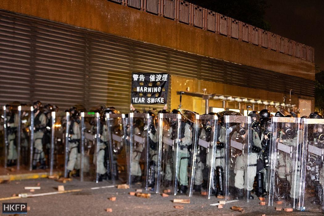 tear smoke gas riot police 14 july sha tin china extradition