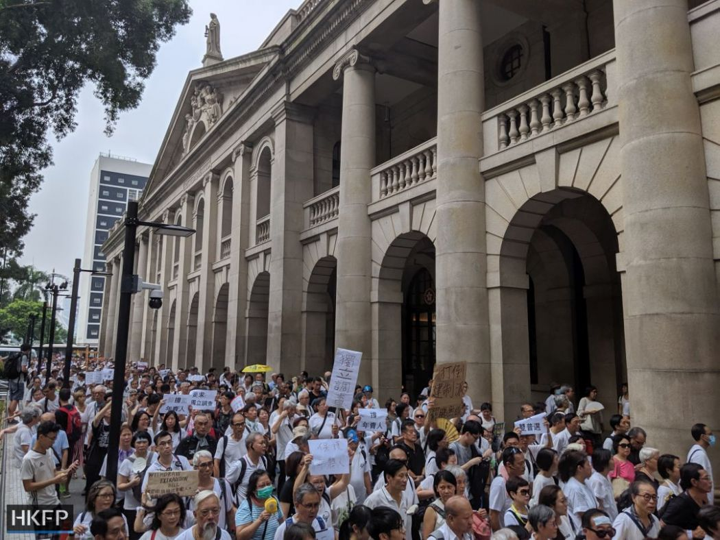 extradition protest elderly silver haired