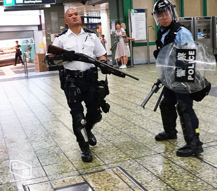 gun police remington july 30 china extradition kwai chung police station (4)