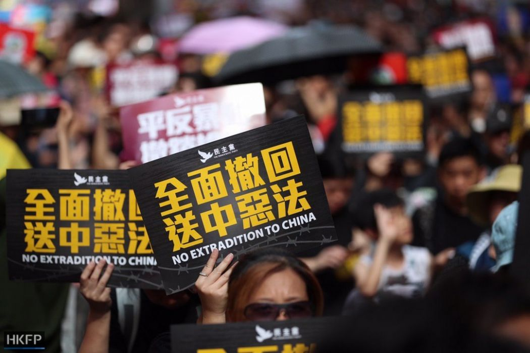 Hong Kong protesters defy police ban and march again