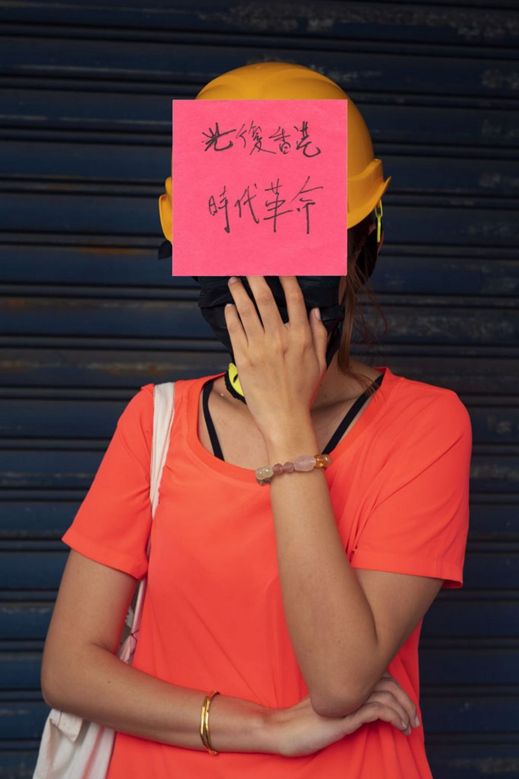 Hong Kong protesters movement without face sticker notes
