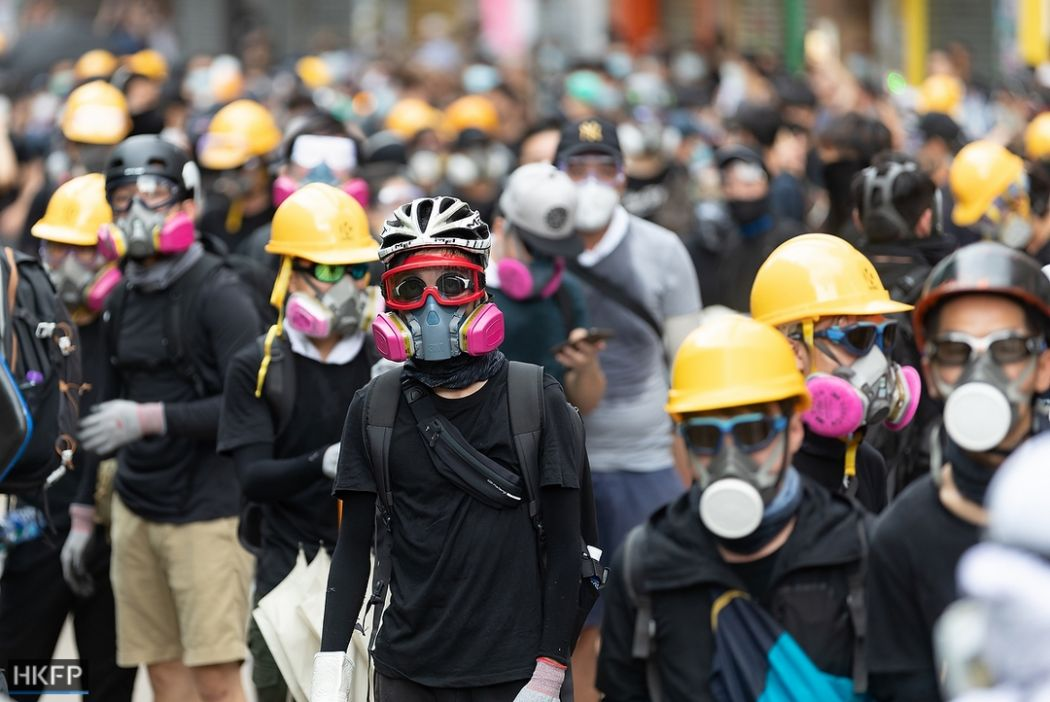 Hong Kong protesters march in peace after weeks of chaos