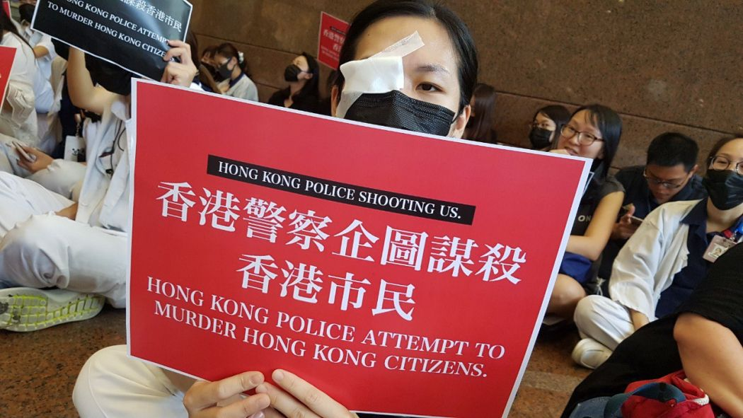 Order returns to Hong Kong airport, but tensions linger