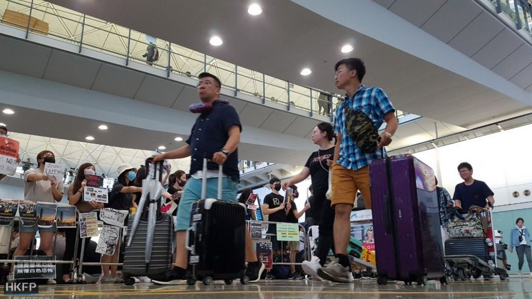hong kong airport august 13 cancellation flight china extradition
