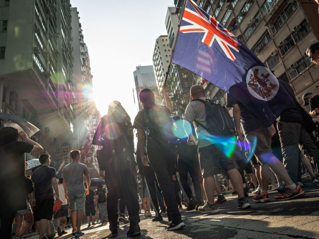 september 15 China extradition protest march UK British colonial flag