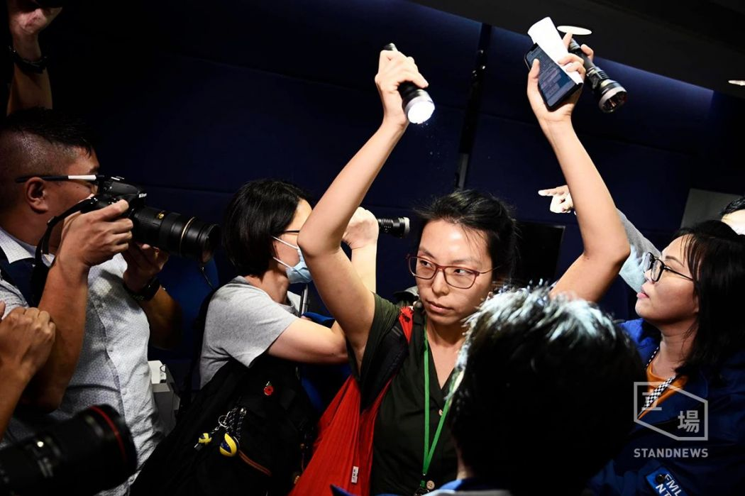 Amy Ip protesting at police press conference