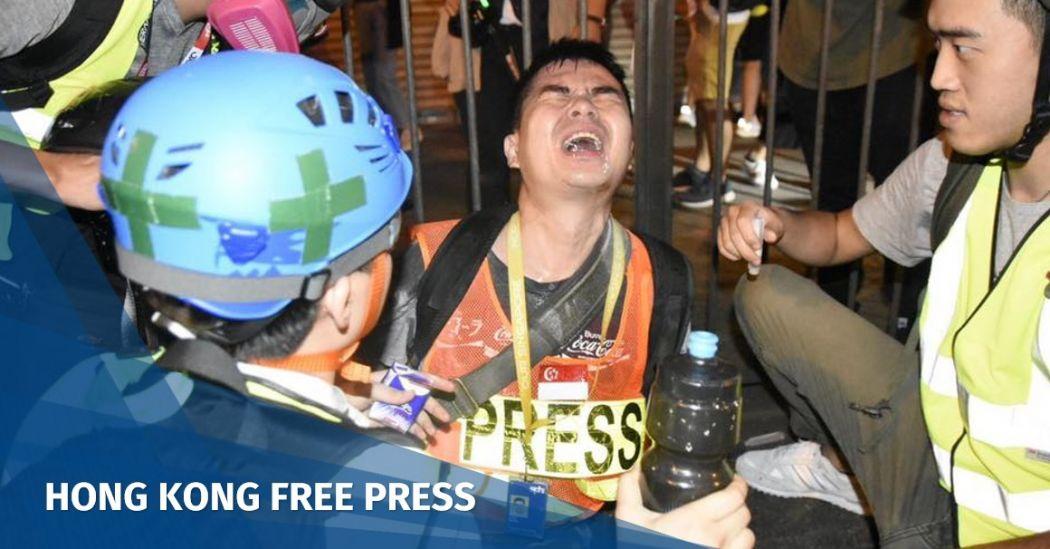 HKJA journalists press protests police