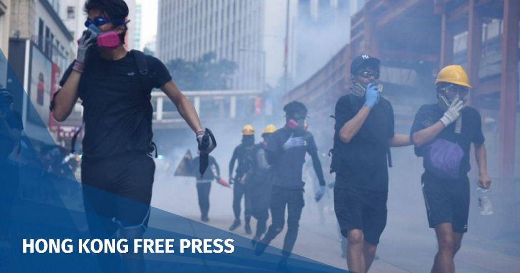 hong kong journalists police