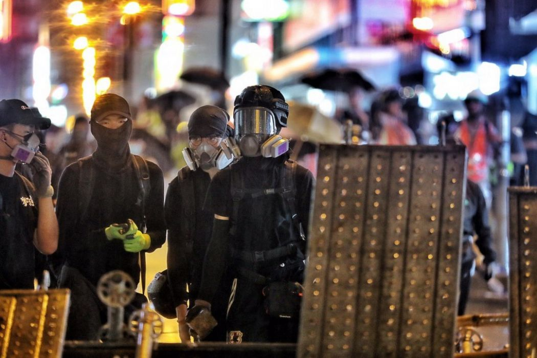 Hong Kong leader says economy taking a hit from protests