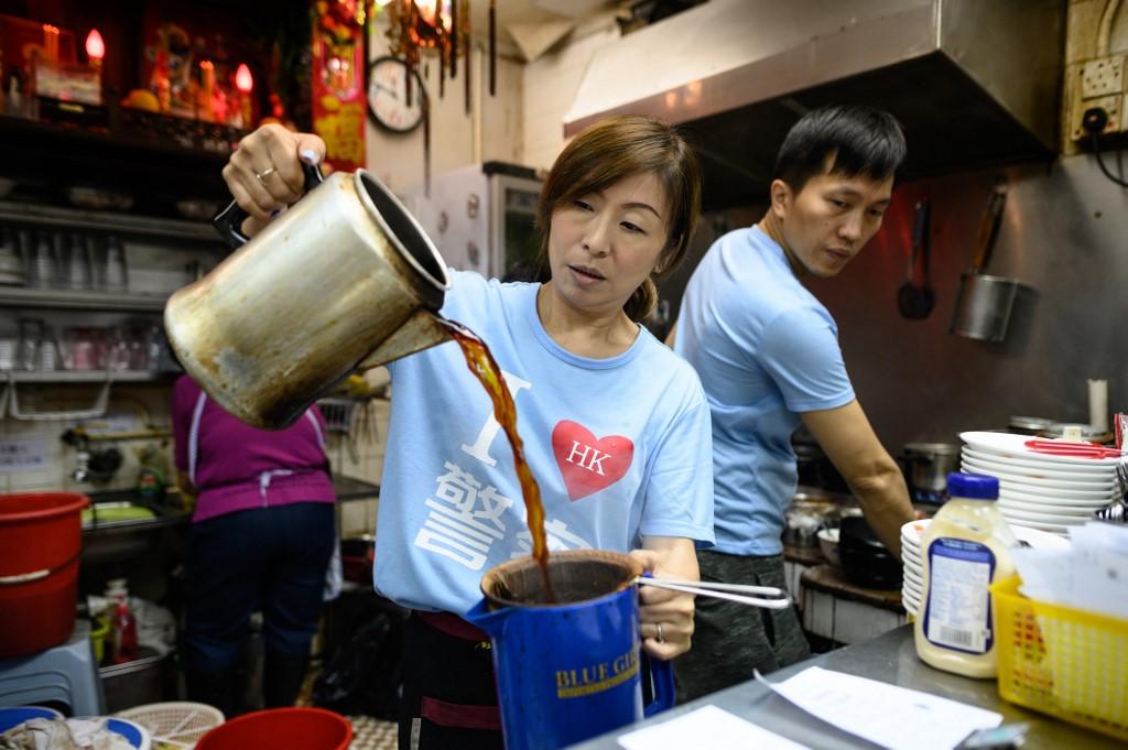 Hong Kong tea house Kate Lea protest I love Hong Kong police t-shirt
