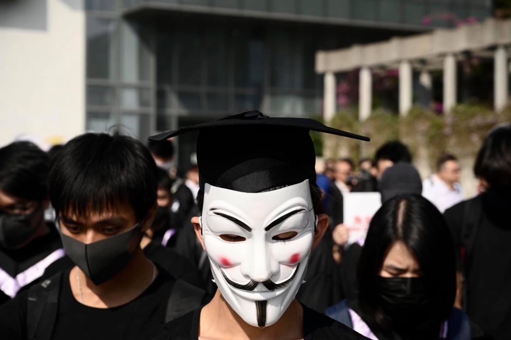 Masked college students meet in graduation rites in Hong Kong