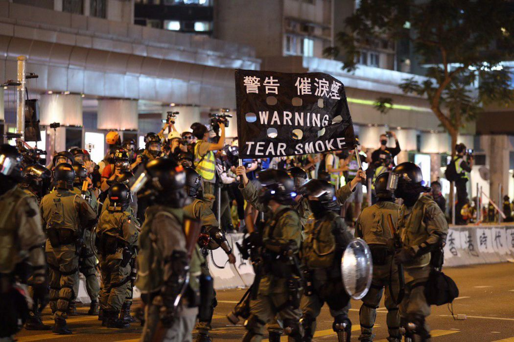 """December 1"" Whampoa Hong Kong police protester streets tear gas warning black flag"
