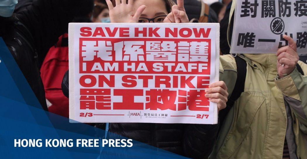 Medics on strike holding placards