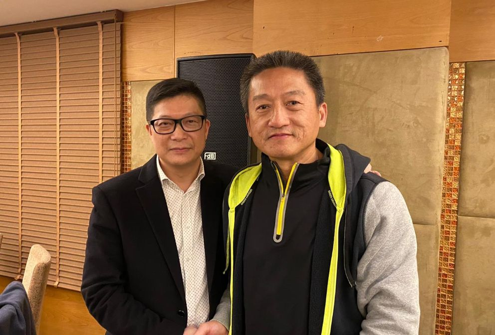 Police chief Chris Tang and convicted officer Frankly Chu.