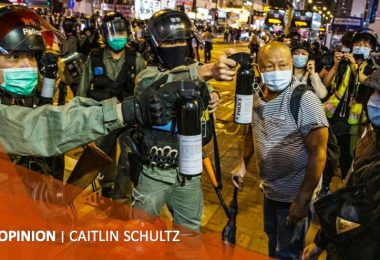 Caitlin Schultz police riot officers protester