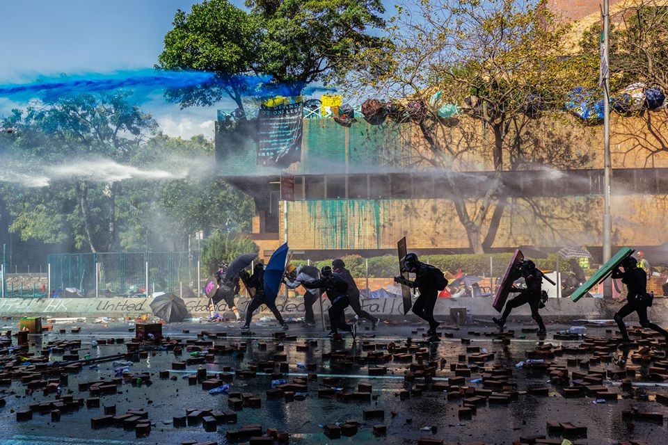 water cannon protesters bricks poly-u