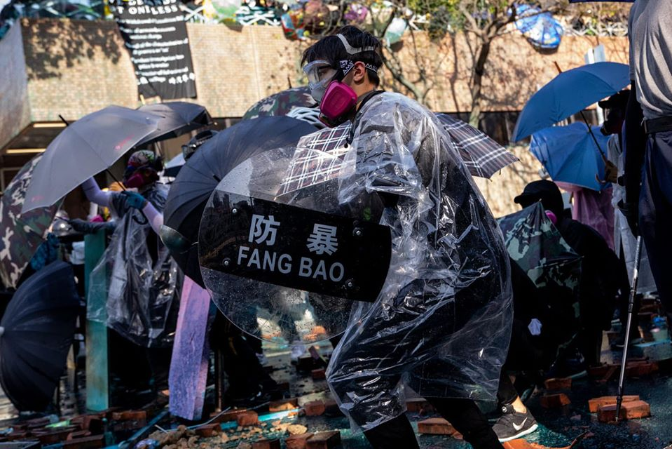 protester with 'fang bao' anti-violent shield