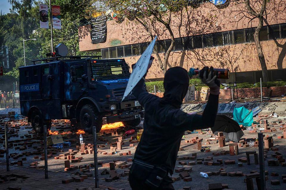 protester molotov cocktail armoured car poly-u