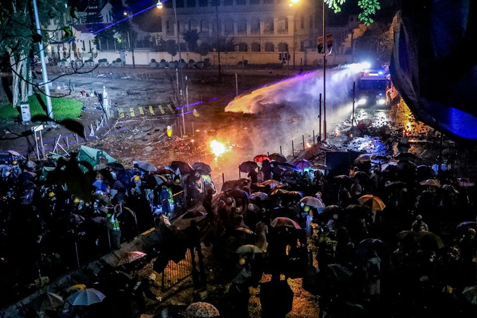 crowd protesters police water cannons poly-u