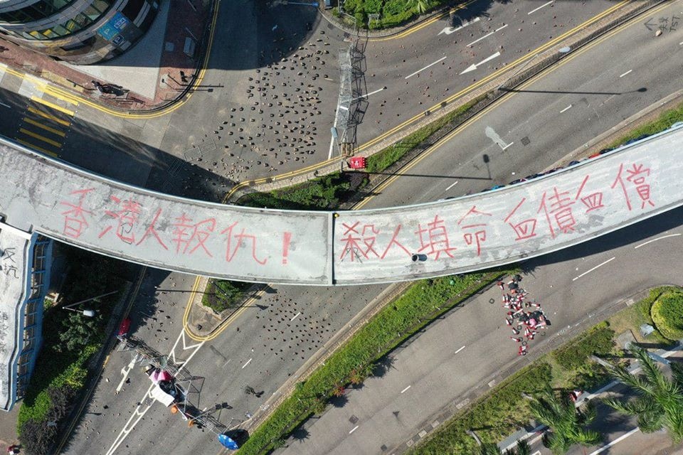 Protester slogans Hongkongers take revenge Poly-UGraffiti on flyover Hongkongers take revenge An eye for an eye