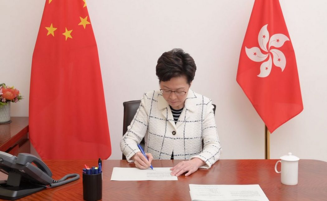 Carrie Lam signs the national security law for Hong Kong.