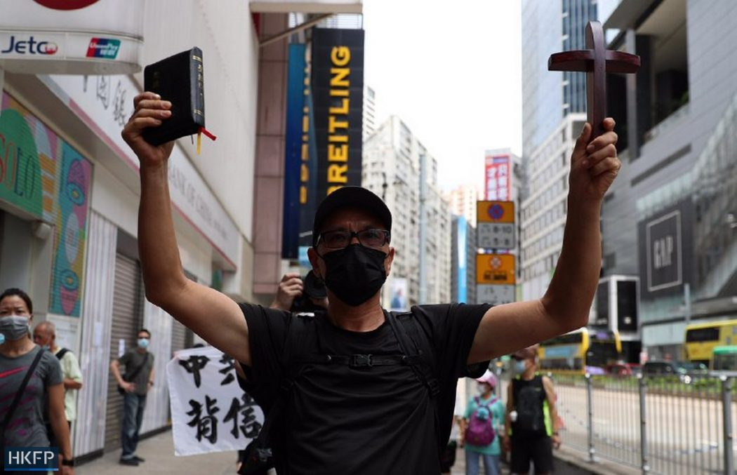 protester religious cross bible causeway bay 1 July 2020