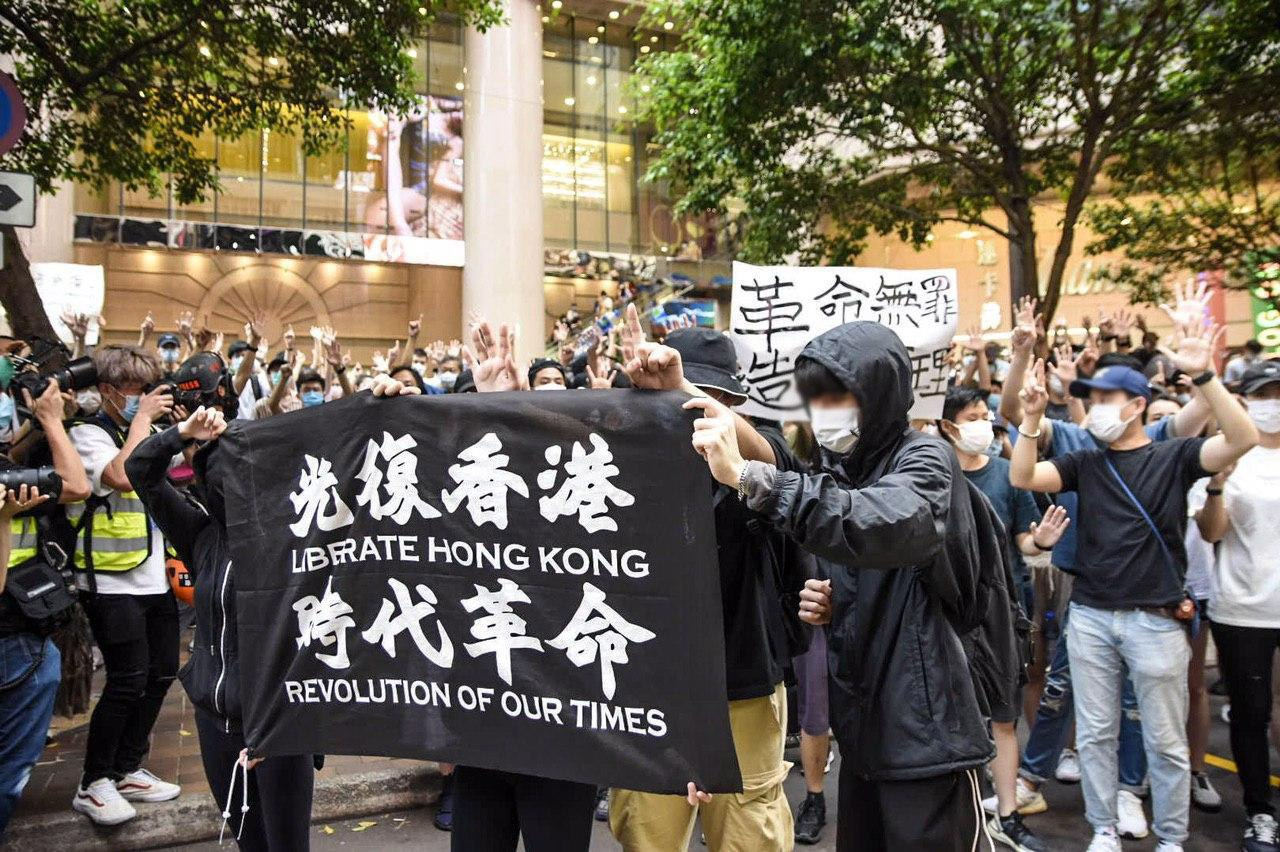 protest march five demands 1 July 2020 causeway bay liberate hong kong flag black flag