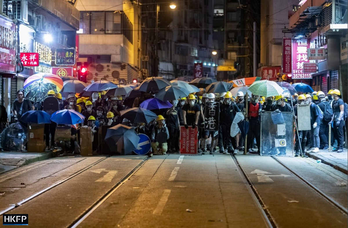 SOPA hands over umbrella helmets to protesters