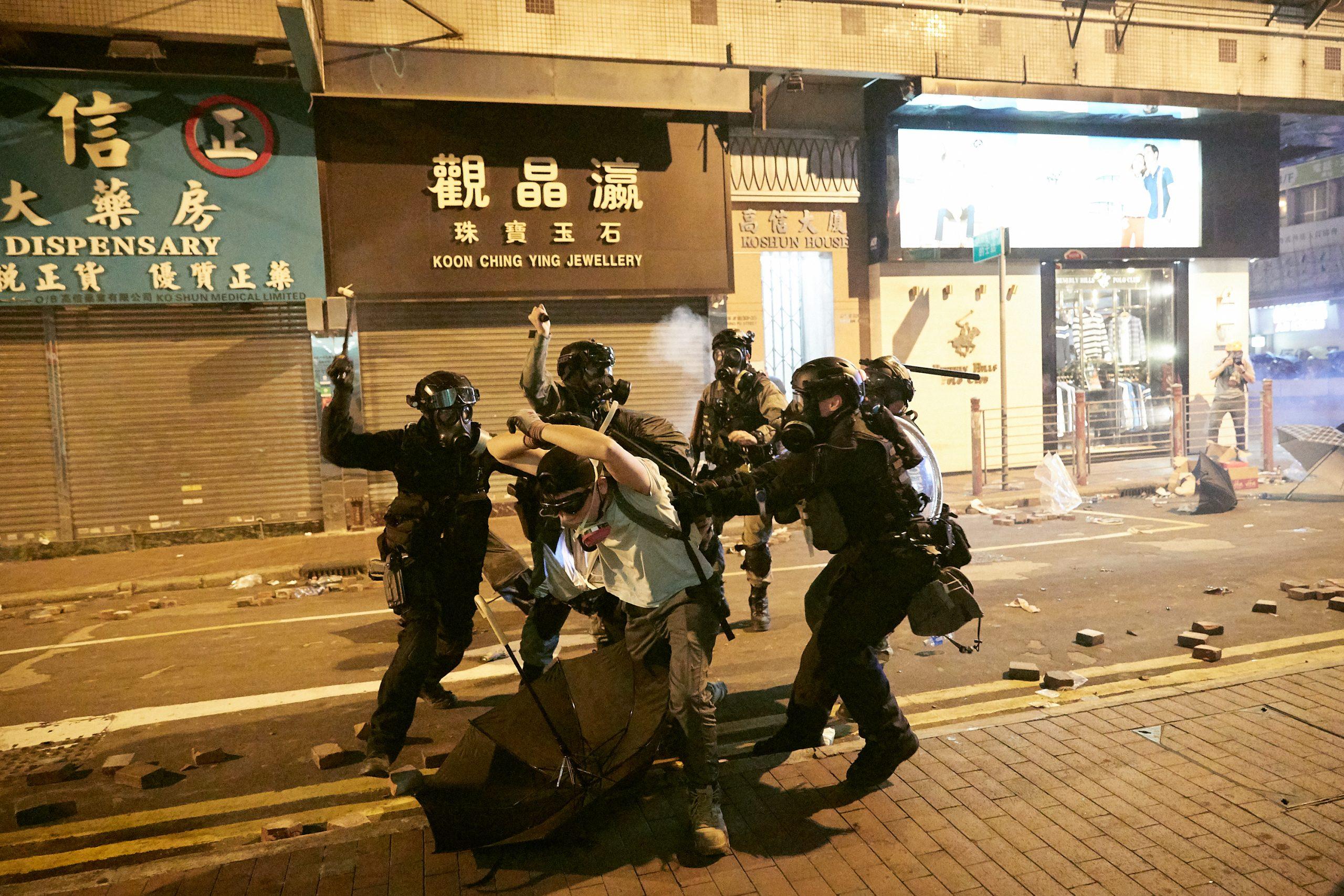 police baton protester beat