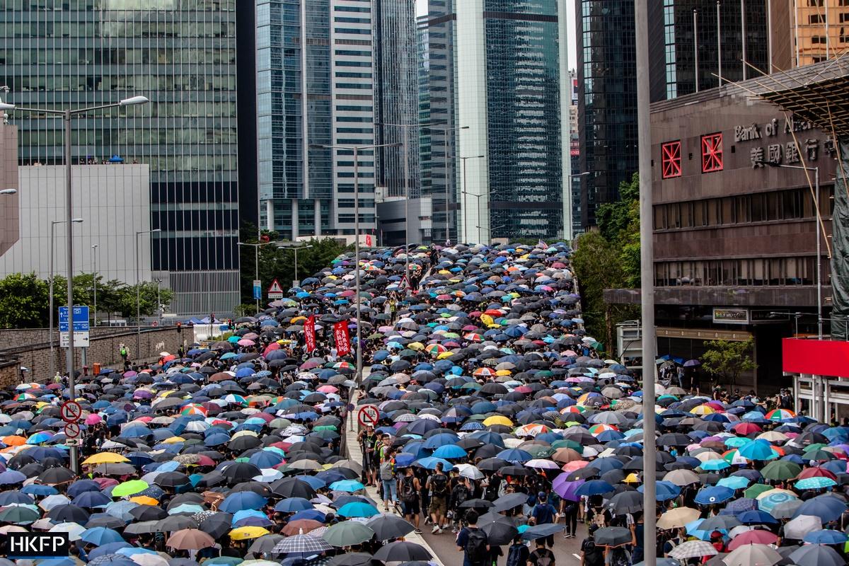 umbrella crowd mass protest