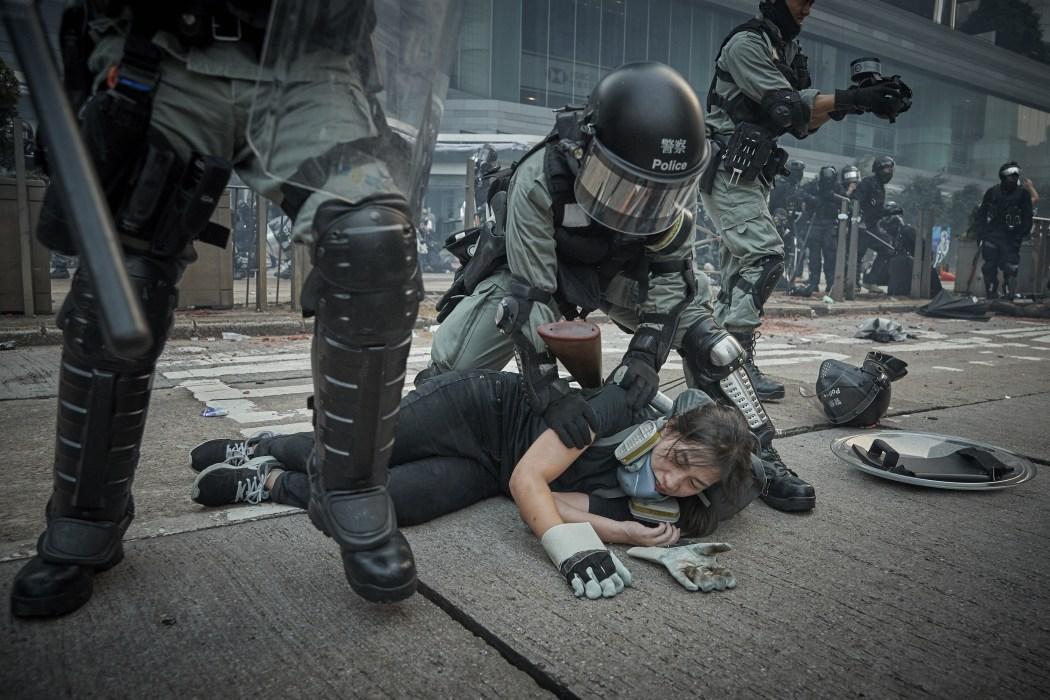 riot police brutality restrain protester arrest