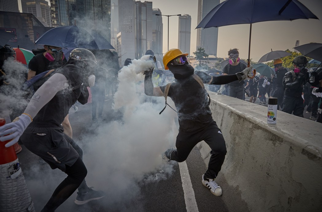Kiran Ridley Tear gas canister protester umbrella