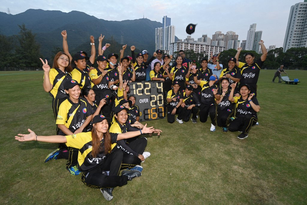 Members of the SCC Divas Cricket Team, made up of domestic helpers from the Philippines celebrating their win against the Kong Cricket Club Cavaliers in Hong Kong.